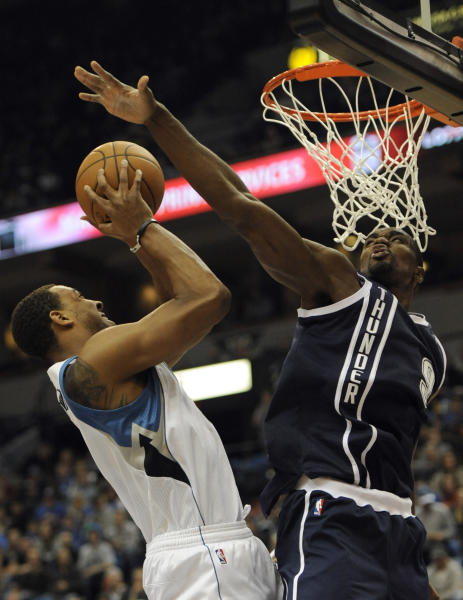 Oklahoma City Thunder's Serge Ibaka, of Congo, blocks a shot by Minnesota Timberwolves' Derrick Williams (7) during the second quarter of an NBA basketball game at the Target Center on Thursday, Dec. 20, 2012, in Minneapolis. (AP Photo/Hannah Foslien)