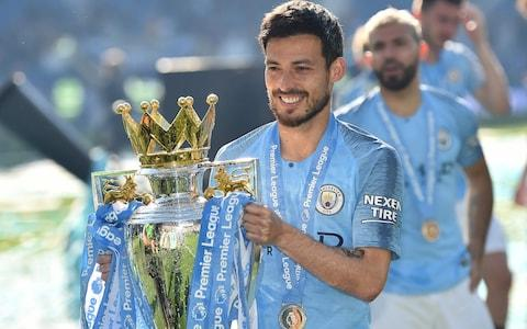 Manchester City's Spanish midfielder David Silva poses with the Premier League trophy after their 4-1 victory in the English Premier League football match between Brighton and Hove Albion and Manchester City - Credit: AFP