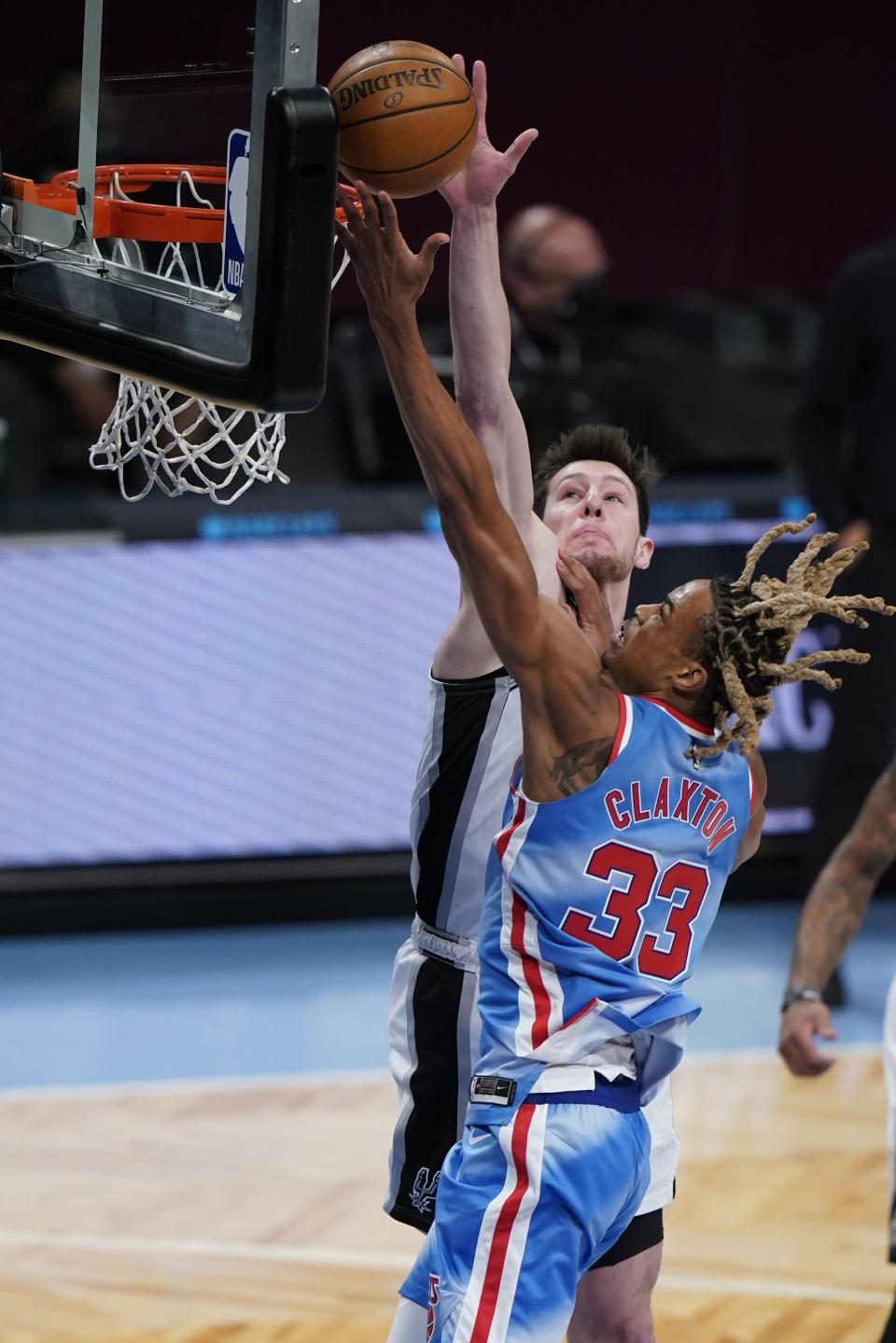 Brooklyn Nets' Nicolas Claxton (33) drives past San Antonio Spurs' Drew Eubanks (14) during the second half of an NBA basketball game Wednesday, May 12, 2021, in New York. (AP Photo/Frank Franklin II)