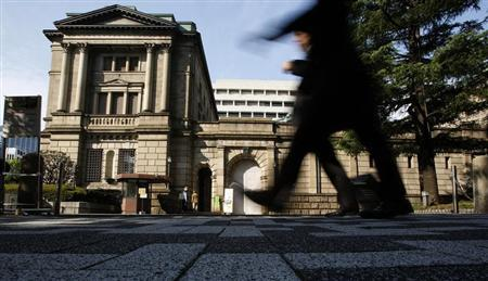 Pedestrians walk past the Bank of Japan building in Tokyo