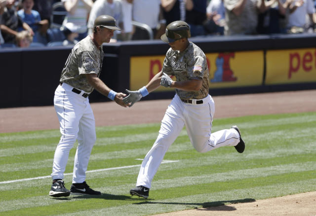 San Diego Padres' Will Venable is greeted by thrid base coach Glenn Hoffman after hitting a home run against the Arizona Diamondbacks during the third inning in a baseball game Sunday, June 16, 2013, in San Diego. (AP Photo/Gregory Bull)