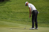 Justin Thomas makes his putt on the eighth green in the first round of play at the Northern Trust golf tournament, Thursday, Aug. 19, 2021, at Liberty National Golf Course in Jersey City, N.J. (AP Photo/John Minchillo)