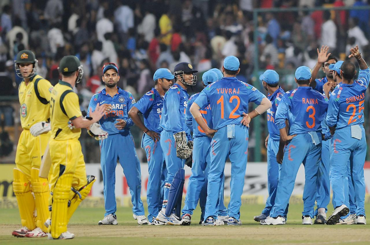 Indian players celebrate a wicket during the 7th ODI between India and Australia played at Chinnaswamy Stadium in Bangalore on Nov.2, 2013. (Photo: IANS)