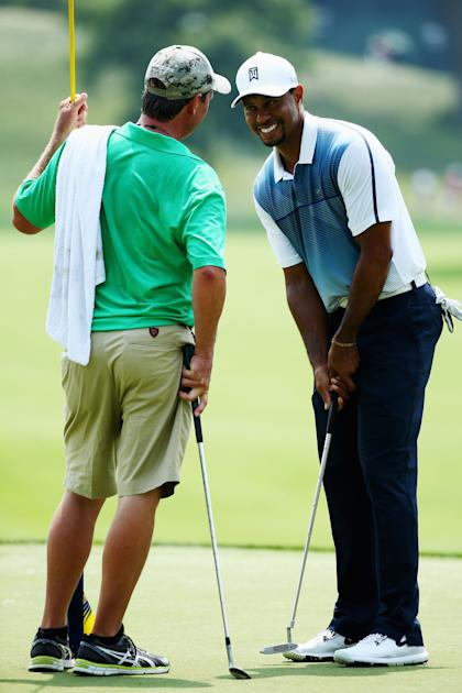 Tiger Woods chats during his practice round at the PGA Championship. (Getty Images)