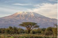 "There are a few epic peaks around the world, like Everest, that you could spend a lifetime preparing to climb. Summiting Kilimanjaro, however, is a much more accessible adventure—local outfitters typically advise a three- to six-month training plan for getting in shape. In addition to the time needed to physically and mentally prepare, it'd be impossible to leave <a href=""https://www.cntraveler.com/story/how-to-visit-tanzania-and-avoid-the-crowds?mbid=synd_yahoo_rss"" rel=""nofollow noopener"" target=""_blank"" data-ylk=""slk:Tanzania"" class=""link rapid-noclick-resp"">Tanzania</a> without a safari in the sprawling Serengeti or a few days of letting your muscles loosen up on the beaches of <a href=""https://www.cntraveler.com/gallery/stunning-photos-of-zanzibars-beaches-and-architecture?mbid=synd_yahoo_rss"" rel=""nofollow noopener"" target=""_blank"" data-ylk=""slk:Zanzibar."" class=""link rapid-noclick-resp"">Zanzibar.</a>"