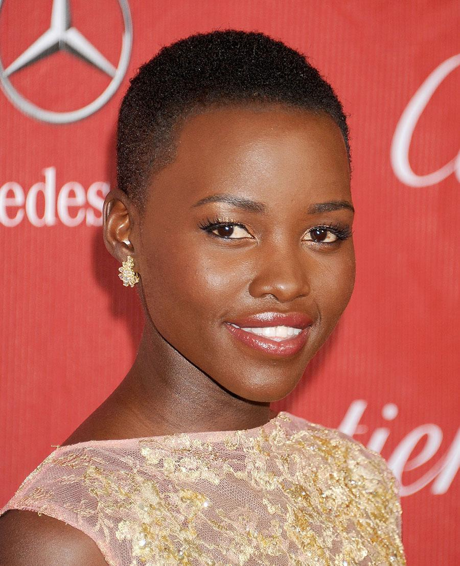 <p>Lupita Nyong'o shows off her naturally textured buzz cut with style and grace at the 25th Annual Palm Springs International Film Festival Awards Gala. (Photo: Getty Images) </p>