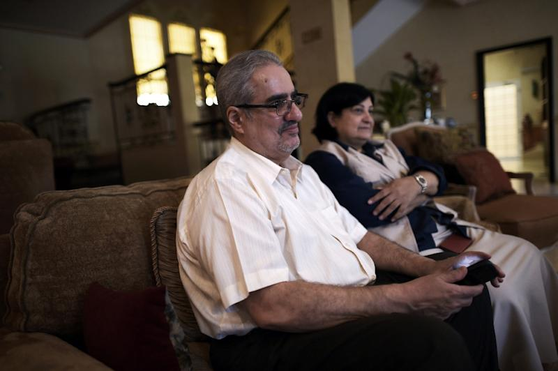 Ibrahim Sharif, then chief of the Waed secular group, sits with his wife Farida Ghulam (R) at their home in the village of Tubli, Bahrain, on June 20, 2015, after being released from jail the day before