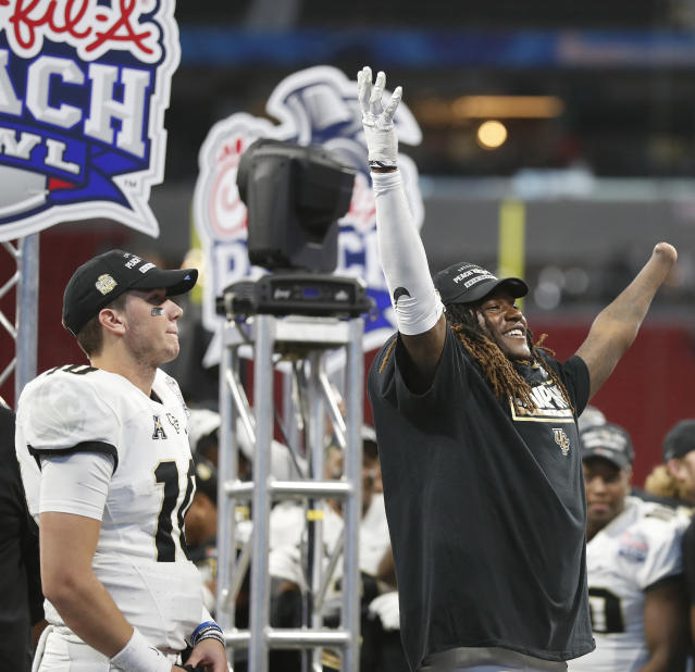 "Central Florida linebacker <a class=""link rapid-noclick-resp"" href=""/ncaaf/players/228732/"" data-ylk=""slk:Shaquem Griffin"">Shaquem Griffin</a>, right, and Central Florida quarterback McKenzie Milton (10) celebrate after the Peach Bowl NCAA college football game against Auburn, Monday, Jan. 1, 2018, in Atlanta. Central Florida won 34-27. (AP Photo/John Bazemore)"