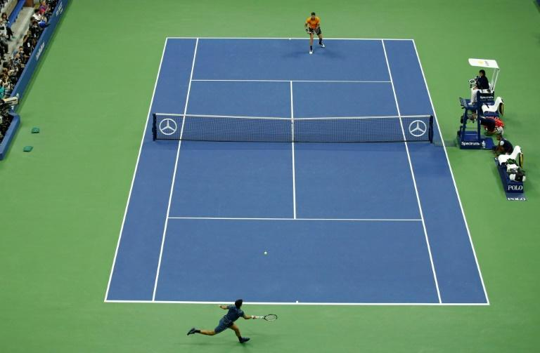 Novak Djokovic and Juan Martin del Potro battle it out in the US Open men's final on Sunday