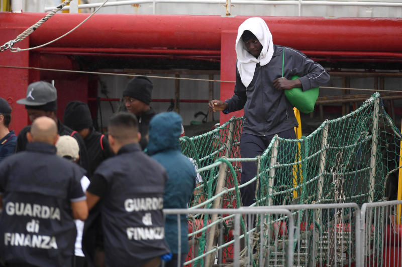 A migrant disembarks the Ocean Viking, docked at the Sicilian port of Messina, southern Italy, Tuesday, Sept. 24, 2019. The humanitarian ship has docked in Sicily, Italy, to disembark 182 men, women and children rescued in the Mediterranean Sea after fleeing Libya. (Carmelo Imbesi/ANSA via AP)