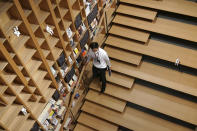 A staff walks at the university's new international house of literature as known as The Haruki Murakami Library at Waseda University Wednesday, Sept. 22, 2021 in Tokyo. The new literary center opening next month on the university campus is no ordinary kind. It's designed by renowned Japanese architect Kengo Kuma and featuring the world of Murakami and his works. (AP Photo/Eugene Hoshiko)