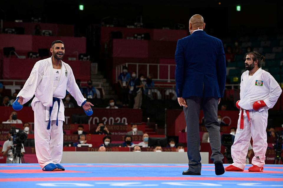 <p>Italy's Luigi Busa reacts to winning the gold medal in the Men's Kumite -75kg karate competition. </p>