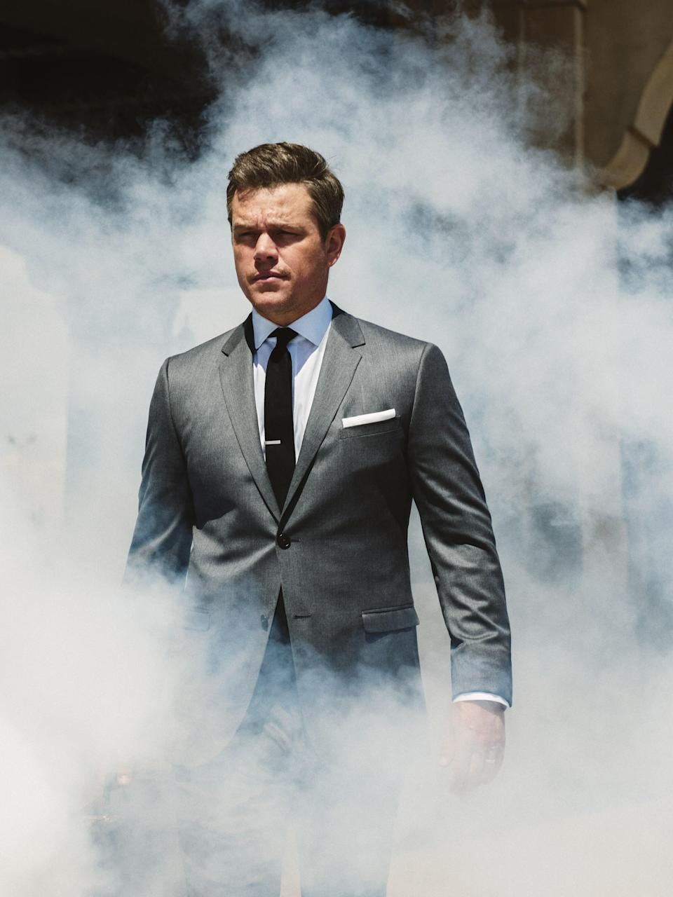 Get back to work in the ultimate businessman fit: gray suit, white dress shirt, black tie. Smoke optional.