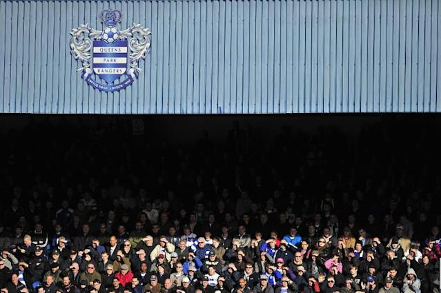 Queens Park Rangers' supporters sit in the afternoon sunshine during a match in London on March 3, 2012 (AFP Photo/Glyn Kirk)
