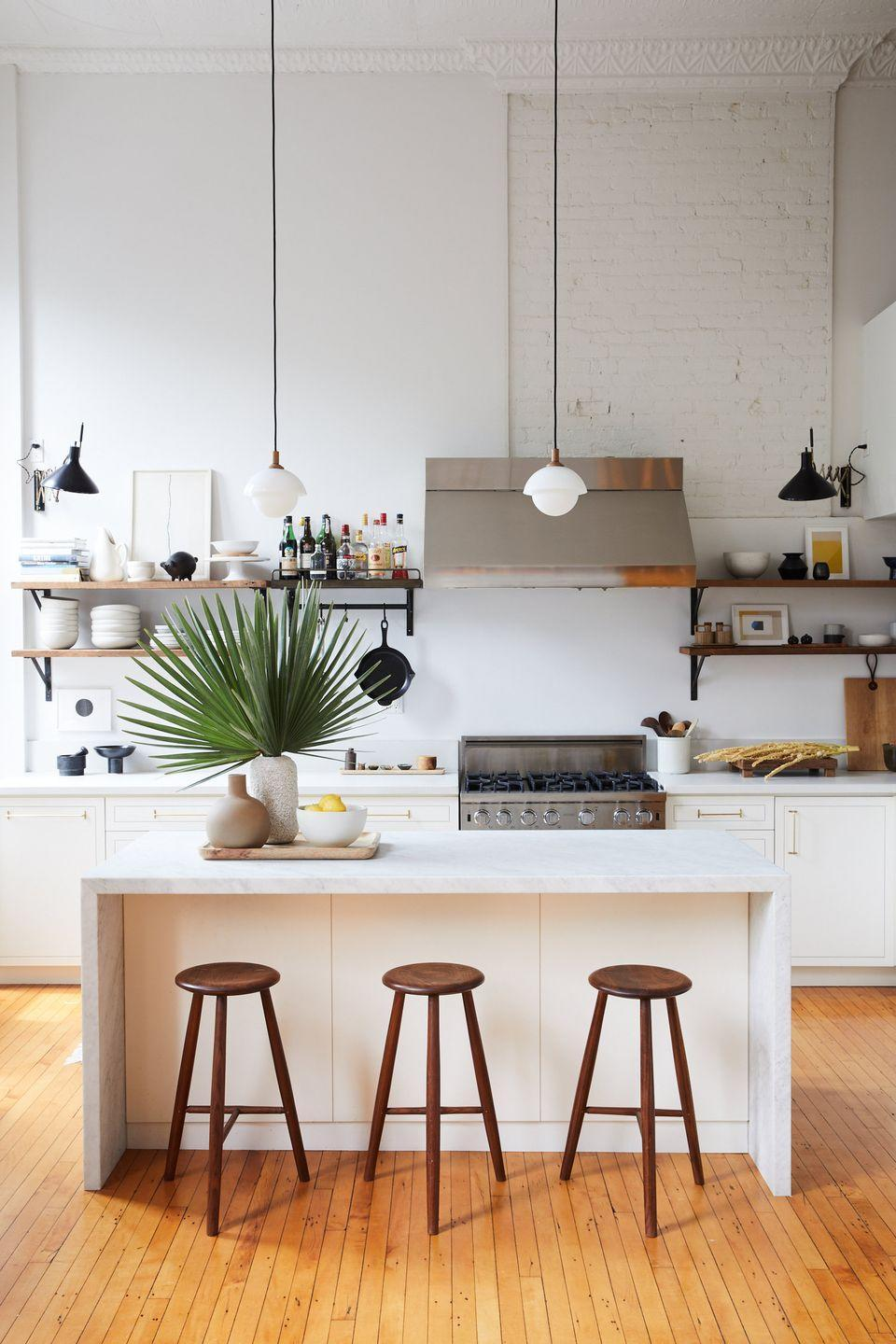 <p>The exposed brick walls add an undone, laid-back feel to this kitchen. Instead of covering them up or refinishing them, let your original architectural details stand out. </p>