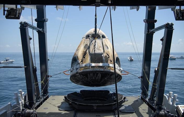"""<br>The SpaceX GO Navigator recovery ship lifts the Crew Dragon capsule """"Endeavour"""" out of the Gulf of Mexico near Pensacola, Florida, on August 2, 2020."""
