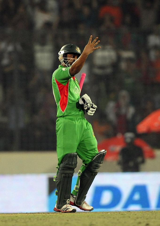 Bangladeshi batsman Tamim Iqbal gestures after scoring a half century (50 runs) during the one day international (ODI) Asia Cup cricket final match between Bangladesh and Pakistan at The Sher-e-Bangla National Cricket Stadium in Dhaka on March 22, 2012. AFP PHOTO/Munir uz ZAMAN (Photo credit should read MUNIR UZ ZAMAN/AFP/Getty Images)