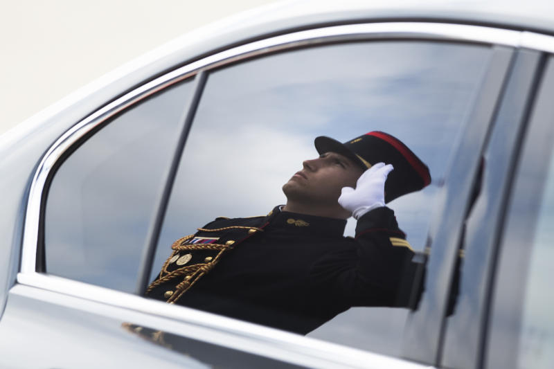 An honor guard is reflected in the window of Italian Prime Minister Giuseppe Conte after his arrival at the airport in Biarritz, France, for the first day of the G-7 summit, Saturday, Aug. 24, 2019. U.S. President Donald Trump and the six other leaders of the Group of Seven nations will begin meeting Saturday for three days in the southwestern French resort town of Biarritz. France holds the 2019 presidency of the G-7, which also includes Britain, Canada, Germany, Italy and Japan. (AP Photo/Peter Dejong)