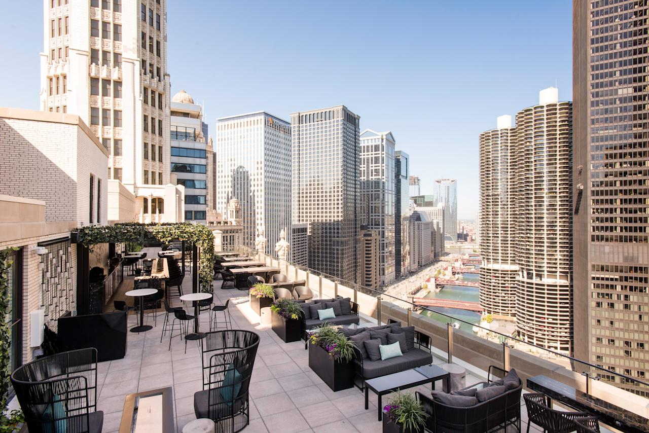 """<p><strong>First impression?</strong><br> You don't really get the feeling for how majestic this place is until you get out on the terrace on the 22nd floor. Most people clock the <a href=""""https://www.cntraveler.com/hotels/chicago/londonhouse-chicago-curio-collection-by-hilton?mbid=synd_yahoo_rss"""">LondonHouse Chicago's</a> standard hotel bar one floor below, but head upstairs to this space, and you feel you're stepping out into the sky with some of the city's iconic buildings as your backdrop.</p> <p><strong>So who's there?</strong><br> The crowd can vary between tourists (and there are plenty), suburban visitors, and locals popping in after work. Dress also moves between fashionable and chic to a bit casual, but that's to be expected in this location just off Michigan Avenue.</p> <p><strong>How are the drinks?</strong><br> While you can get a simple vodka soda or a glass of sauvignon blanc, take this opportunity to opt for a baller drink with your baller view: like the Old Fashionedmade with Basil Hayden's Bourbon, scotch, maple, orange, and angostura bitters.</p> <p><strong>Worth ordering something to eat, too?</strong><br> Many people will come for the drinks and the view, but LH is a proper New American restaurant that supports local farmers and purveyors. You can easily make a meal out of the snacks, like a half-dozen oysters or the pile of truffle fries and foie gras, but larger dishes like the LH Burgerwith garlic aioli, cucumber slaw, and Beemster gouda on a brioche bun don't disappoint.</p> <p><strong>Did the staff do you right?</strong><br> Depending on the time, the bar can get pretty packed. Make a reservation for a table on the terrace; otherwise you'll stand two to three deep at the bar waiting to catch someone's eye. When seated, servers tend to check in regularly, but if it's busy, they can get in the weeds and disappear for a bit.</p> <p><strong>Wrap it up: what are we coming here for?</strong><br> The food is delicious, but you're really coming to """