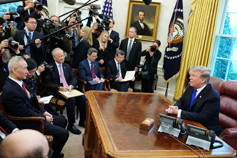 US President Donald Trump (R) takes part in a meeting with China's Vice Premier and lead negotiator Liu He (L) in the Oval Office