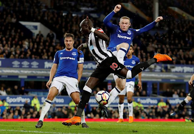 "Soccer Football - Premier League - Everton v Newcastle United - Goodison Park, Liverpool, Britain - April 23, 2018 Everton's Wayne Rooney and Phil Jagielka in action with Newcastle United's Mohamed Diame Action Images via Reuters/Lee Smith EDITORIAL USE ONLY. No use with unauthorized audio, video, data, fixture lists, club/league logos or ""live"" services. Online in-match use limited to 75 images, no video emulation. No use in betting, games or single club/league/player publications. Please contact your account representative for further details."