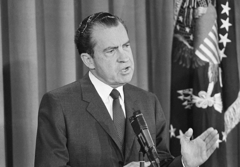 FILE - In this Jan. 27, 1963, file photo President Richard Nixon speaks during first news conference as president in the East Room of the White House in Washington. (AP Photo, File)