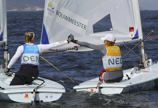 2016 Rio Olympics - Sailing - Final - Women's One Person Dinghy - Laser Radial - Medal Race - Marina de Gloria - Rio de Janeiro, Brazil - 16/08/2016. Marit Bouwmeester (NED) of Netherlands is congratulated by Anne-Marie Rindom (DEN) of Denmark. REUTERS/Brian Snyder FOR EDITORIAL USE ONLY. NOT FOR SALE FOR MARKETING OR ADVERTISING CAMPAIGNS.