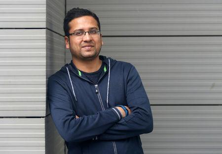 FILE PHOTO - Bansal, Group CEO of Flipkart, poses at the company's HQ in Bengaluru