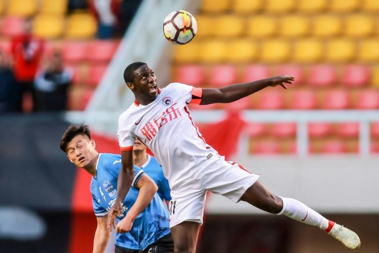 Jacob Mulenga (R) says he's owed hundreds of thousands of dollars after Liaoning Hongyun FC went bust