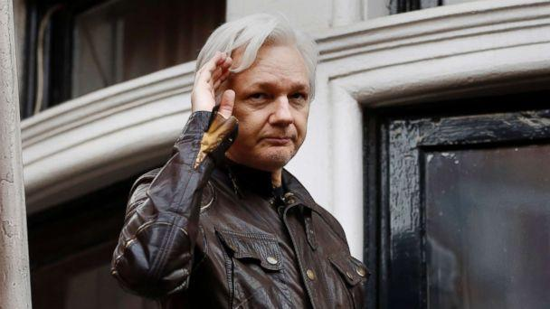 PHOTO: WikiLeaks founder Julian Assange greets supporters from a balcony of the Ecuadorian embassy in London, May 19, 2017. (Frank Augstein/AP, FILE)