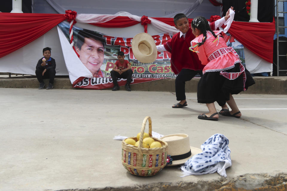 Young supporters of the new President Pedro Castillo dance on his inauguration day after watching his swearing-in ceremony via live broadcast on a screen set up in Tacabamba, Peru, located in the Cajamarca department where Castillo is from, Wednesday, July 28, 2021. (AP Photo/Francisco Vigo)