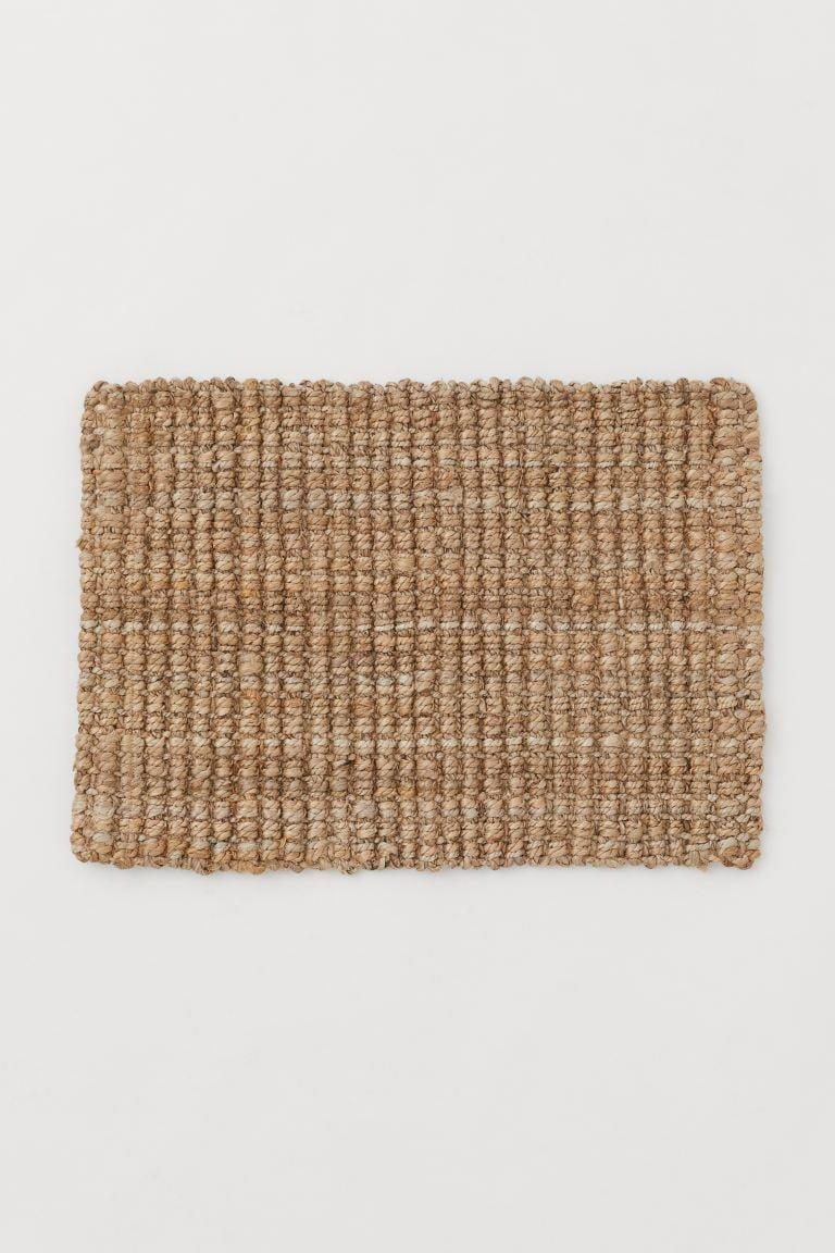 "<p>Your entryway needs this classic <a href=""https://www.popsugar.com/buy/HampM-Jute-Doormat-584968?p_name=H%26amp%3BM%20Jute%20Doormat&retailer=www2.hm.com&pid=584968&price=25&evar1=casa%3Aus&evar9=45784601&evar98=https%3A%2F%2Fwww.popsugar.com%2Fhome%2Fphoto-gallery%2F45784601%2Fimage%2F47575732%2FHM-Jute-Doormat&list1=shopping%2Cproducts%20under%20%2450%2Cdecor%20inspiration%2Caffordable%20shopping%2Chome%20shopping&prop13=api&pdata=1"" class=""link rapid-noclick-resp"" rel=""nofollow noopener"" target=""_blank"" data-ylk=""slk:H&M Jute Doormat"">H&M Jute Doormat</a> ($25).</p>"