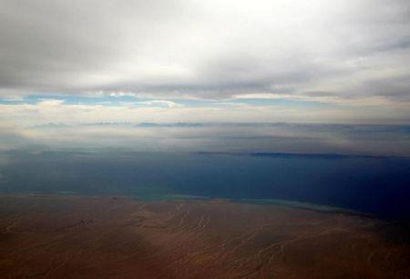 An aerial view of the coast of the Red Sea and the two islands of Tiran and Sanafir is pictured through the window of an airplane near Sharm el-Sheikh