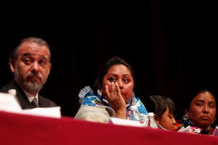 Alberta Alcantara (C) and Teresa Gonzalez (R), two of three indigenous women who were wrongfully jailed for years, sit with Attorney General Raul Cervantes after a formal apology from the Attorney General's Office, in Mexico City, Mexico February 21, 2017. REUTERS/Carlos Jasso