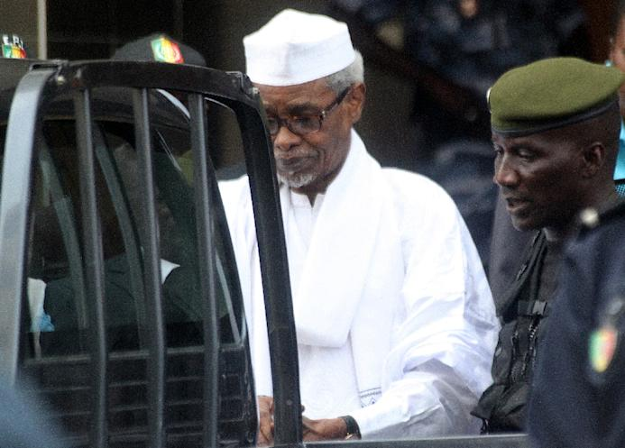 Former Chadian dictator Hissene Habre is escorted by military officers after being heard by a judge on July 2, 2013 in Dakar, Senegal