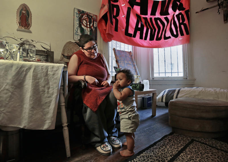 "In this Friday, Feb. 17, 2017 photo, Franki Velez looks at her son Ashoka Little, 1, in their home in Oakland, Calif. An Iraq War veteran who says she is on disability for Post Traumatic Stress Disorder, Velez is a full-time activist who is simultaneously cheered by and worried about the post-Trump infusion of more traditional liberals eager to protest. ""I see a lot of liberal people talking about reforming the system,"" said Velez, whose parents are Puerto Rican and whose mother's family was shipped to Hawaii to work on sugar plantations. ""They don't understand it's a colonial system that's never meant to be reformed."" (AP Photo/Ben Margot)"