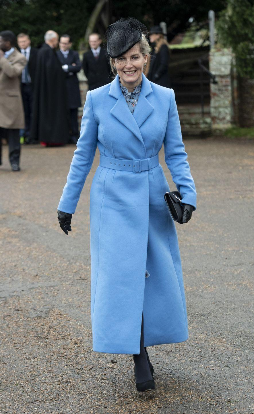 <p>The Countess of Wessex looked chic in a belted light blue coat as she joined the rest of the royal family for the Christmas Day church service at Sandringham. Sophie topped off her look with a black fascinator, clutch and pumps. </p>