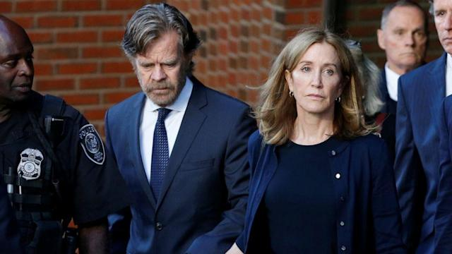 Actress Felicity Huffman seen in prison uniform, green jumpsuit and white hat (ABC News)