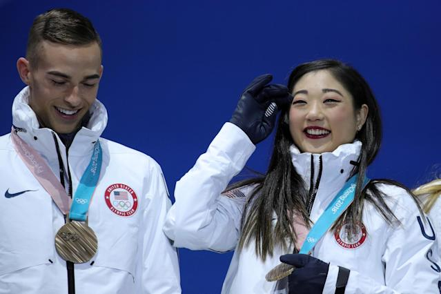 Adam Rippon and Mirai Nagasu with their bronze medals from the figure skating team event at the 2018 PyeongChang Olympics. (Getty)