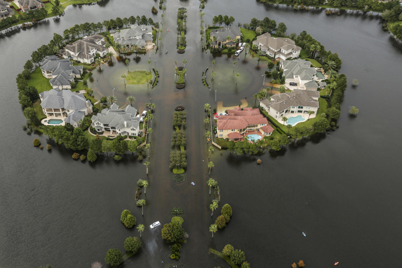 <p>Floodwaters fill the road running through the Lakes On Eldridge North subdivision in the aftermath of Tropical Storm Harvey on Wednesday, Aug. 30, 2017, in Houston. (Photo: Brett Coomer/Houston Chronicle via AP) </p>