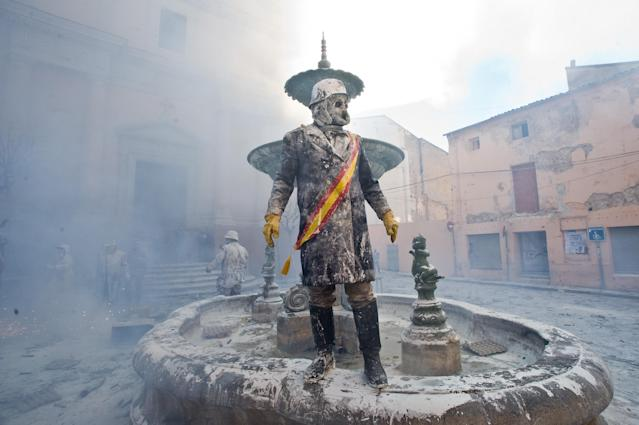 IBI, SPAIN - DECEMBER 28: A Reveller takes part in the battle of 'Enfarinats', a flour fight in celebration of the Els Enfarinats festival on December 28, 2012 in Ibi, Spain. Citizens of Ibi annually celebrate the festival with a battle using flour, eggs and firecrackers. The battle takes place between two groups, a group of married men called 'Els Enfarinats' which take the control of the village for one day pronouncing a whole of ridiculous laws and fining the citizens that infringe them and a group called 'La Oposicio' which try to restore order. At the end of the day the money collected from the fines is donated to charitable causes in the village. The festival has been celebrated since 1981 after the town of Ibi recovered the tradition but the origins remain unknown.Ê (Photo by David Ramos/Getty Images)