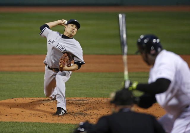 New York Yankees starting pitcher Masahiro Tanaka delivers to Boston Red Sox designated hitter David Ortiz during the first inning of a baseball game at Fenway Park in Boston, Tuesday, April 22, 2014. (AP Photo/Elise Amendola)
