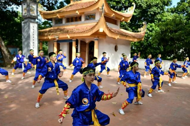 Thien Mon Dao martial arts students practise inside the Bach Linh temple compound at Du Xa Thuong village in Hanoi (AFP Photo/Manan VATSYAYANA)