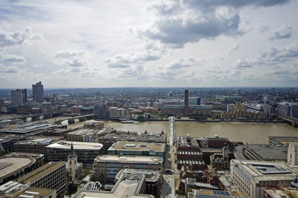 View to the south towards the Millennium Bridge, Tate Modern and River Thames from the top of St Pauls Cathedral in the City of