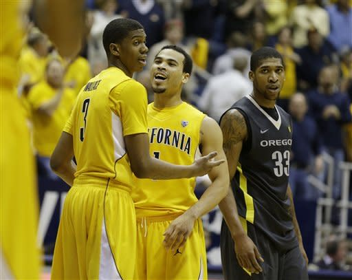 California guards Tyrone Wallace, left and Justin Cobbs, middle, greet each other as Oregon forward Carlos Emory, right, looks on in the closing moments of their NCAA college basketball game Saturday, Feb. 2, 2013 in Berkeley, Calif. California won the game 58-54. (AP Photo/Eric Risberg)