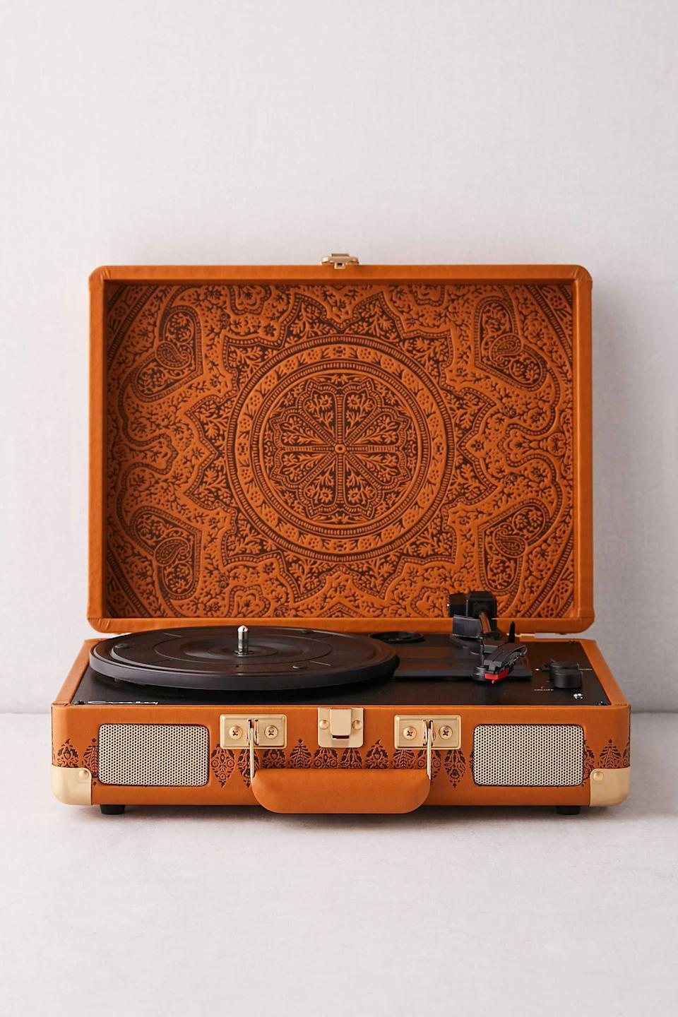 """<p><strong>Crosley</strong></p><p>urbanoutfitters.com</p><p><strong>$99.00</strong></p><p><a href=""""https://go.redirectingat.com?id=74968X1596630&url=https%3A%2F%2Fwww.urbanoutfitters.com%2Fshop%2Fcrosley-uo-exclusive-debossed-medallion-cruiser-bluetooth-record-player&sref=https%3A%2F%2Fwww.seventeen.com%2Flove%2Fdating-advice%2Fadvice%2Fg606%2Fboyfriend-gifts%2F"""" rel=""""nofollow noopener"""" target=""""_blank"""" data-ylk=""""slk:Shop Now"""" class=""""link rapid-noclick-resp"""">Shop Now</a></p><p>This portable turntable looks almost as good as it sounds. Yeah, peep that retro plaid print straight out of <em>Mad Men</em>. </p>"""