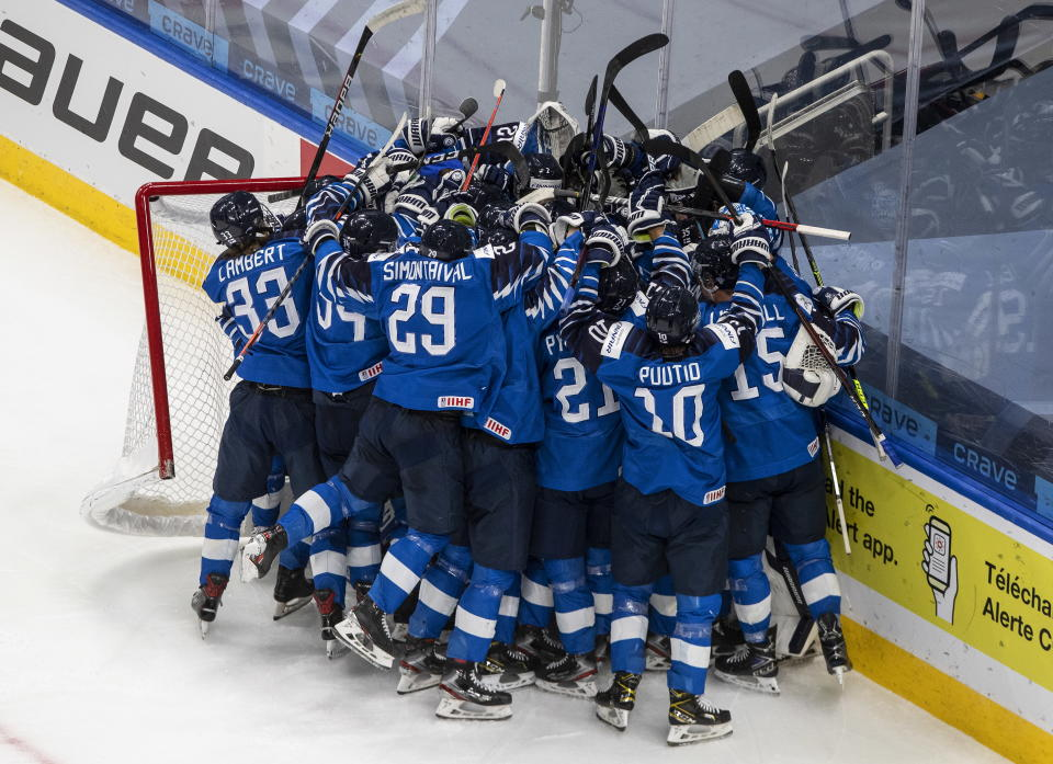 Finland celebrates the win over Sweden after an IIHL World Junior Hockey Championship game, Saturday, Jan. 2, 2021 in Edmonton, Alberta. (Jason Franson/The Canadian Press via AP)