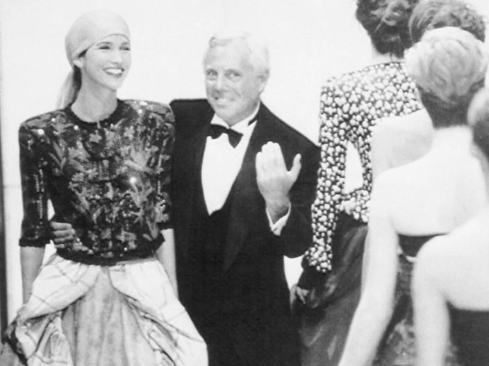 "Armani talks to a model at a Los Angeles fashion show in 1988. <p class=""copyright"">AP Images</p>"