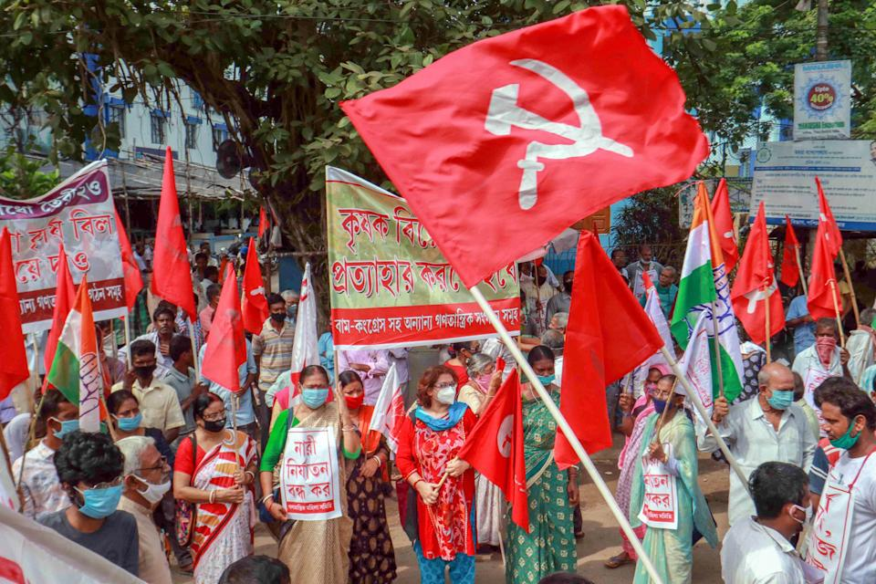 Members of various political parties block Santiniketan road during a protest against the farm bills passed in both the Houses of Parliament recently, at Bolpur in Birbhum district, Friday, Sept. 25, 2020. (PTI Photo)