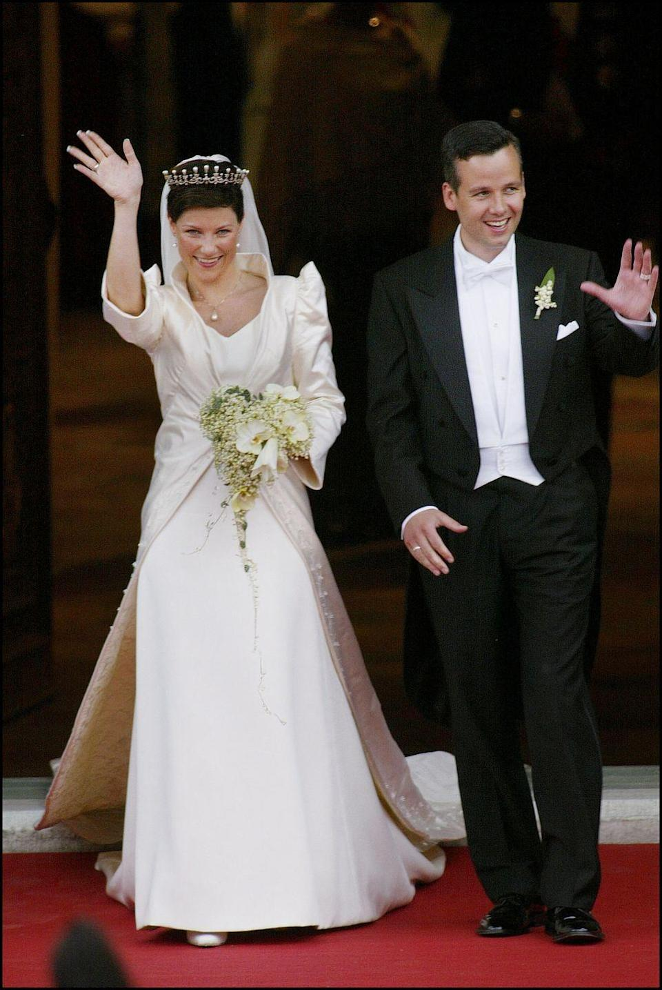 <p>Princess Martha-Louise and Ari Behn of Norway were married in Trondheim, Norway on May 24, 2002. Princess Martha-Louise's two-piece gown consisted of a Swarovski crystal-embellished coat with trumpet sleeves and a 9-foot train. The dress underneath was a simple, sleeveless white silk crêpe.</p>